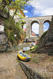 Yellow air rafts under the stone bridge in city of Cesky Krumlov Stock Photo