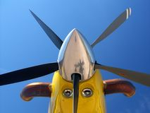Yellow aircraft nose. And five-bladed propeller Stock Photography
