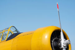 Yellow airplane. The nose with propeller of a yellow airplane stock photos