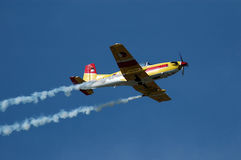 Yellow airplane. Yellow sport plane is giving a airshow, fly by Royalty Free Stock Photography