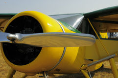 Yellow airplane with chrome propeller Stock Image