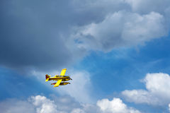 Yellow Airplane flying above clouds Royalty Free Stock Images