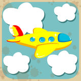 Yellow airplane flying through the sky with clouds Royalty Free Stock Photography