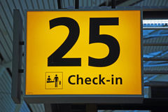 Yellow airport direction check-in sign. Detailed view of yellow airport check-in sign Stock Image