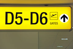 Yellow airport direction departure sign. Detailed  view of yellow airport departure sign showing direction to gates Stock Image