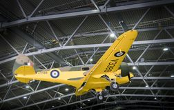 Yellow Airspeed Oxford AS.10  Aircraft Suspended in Hangar. Airspeed Oxford AS.10 aircraft on display in the AirSpace hangar at Imperial War Museum, Duxford, UK Royalty Free Stock Photography