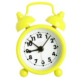 Yellow alarm clock. With bells isolated on white Stock Photos