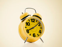 Yellow alarm clock on background. Time to wake up Stock Photo