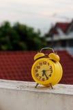 Yellow alarm clock Stock Image