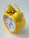 Yellow alarm clock Stock Images