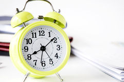 Yellow alarm clock on desk Royalty Free Stock Photography