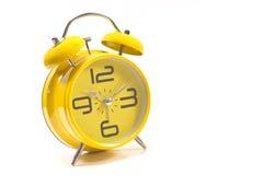 Yellow alarm clock isolated Stock Photo