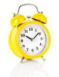 Yellow alarm clock Stock Images