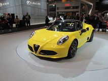 Yellow Alfa Romeo car. 2015 New York International Auto Show. Stock Image