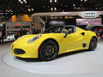Yellow Alfa Romeo car. 2015 New York International Auto Show. Royalty Free Stock Photo