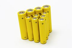 Yellow alkaline batteries. Group of yellow anonymous alkaline batteries isolated on white background Stock Image