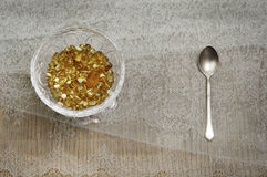 Yellow amber. In a crystal vase on the table Royalty Free Stock Photo