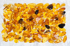 Yellow amber stones. Lie on a flat surface Royalty Free Stock Image