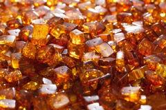 Yellow amber stones. Rectangular closeup lie on a flat surface Stock Photography