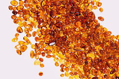 Yellow amber stones,. Yellow amber stones on a white background Stock Images