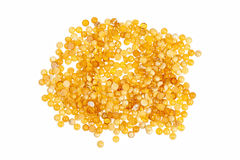 Yellow amber stones. Yellow amber stones on a white background Stock Image