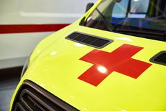 Yellow ambulance car with red cross Royalty Free Stock Photography