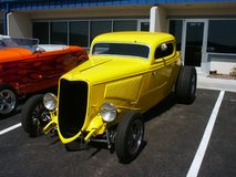 Yellow American Hotrod. Yellow Antique American Hotrod coupe Stock Photos