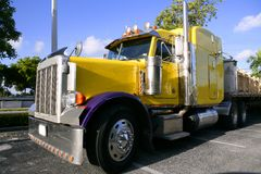 Yellow american truck with stainelss steel Royalty Free Stock Images