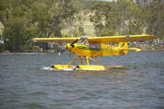 Yellow amphibious seaplane taking off from Lake Casitas, Ojai, California Royalty Free Stock Photos
