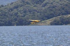 Yellow amphibious seaplane taking off from Lake Casitas, Ojai, California Stock Photography