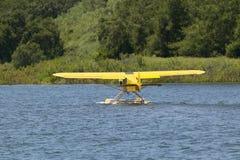 Yellow amphibious seaplane taking off from Lake Casitas, Ojai, California Royalty Free Stock Photography