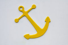 Yellow Anchor on white wall Royalty Free Stock Image