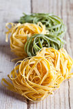 Yellow And Green Uncooked Pasta Tagliatelle Stock Photography