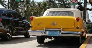 Yellow Antique 1955 Oldsmobile In Miami Beach. Miami, Florida / USA, February 24, 2019: Yellow Antique 1955 Oldsmobile Super 88 Convertible Parked On Ocean Drive stock video footage