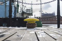 Yellow Anvil Beside Green Boat Royalty Free Stock Image