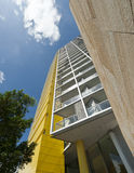 Yellow apartment block Stock Photo