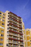 Yellow apartment buildings Stock Images