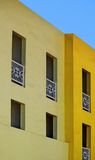Yellow Apartments and Blue Sky Stock Photography