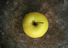 Yellow apple. Photo of a yellow apple on a piece of wood (shallow DOF Stock Photos