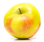 Yellow apple. The ripe juicy yellow apple. Isolation on white Stock Photos
