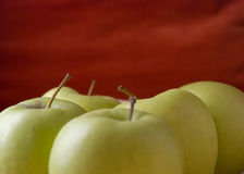 Yellow apple. On red background Stock Images