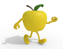 Yellow apple with arms and legs Royalty Free Stock Images