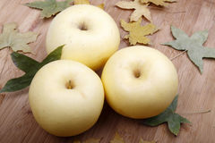 Yellow apple in autumn Royalty Free Stock Images