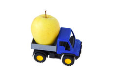Yellow apple in the back of the toy car. Isolated Royalty Free Stock Photo