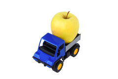 Yellow apple in the back of the toy car. Isolated Stock Images