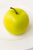 Yellow apple-close up-on the p Royalty Free Stock Photos