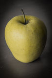 Yellow apple. In dark point of view Stock Photography
