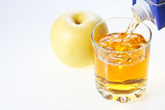 Yellow apple and glass of juice Stock Photo
