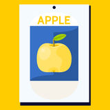 Yellow apple with green leaf on blue background Royalty Free Stock Image