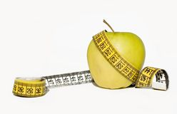 Yellow apple and measurement tape Stock Image